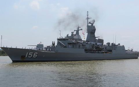 Royal Australian Navy frigate HMAS Toowoomba prepares to dock at Saigon port in Ho Chi Minh City, Vietnam after reports that three ships were challenged by China in the South China Sea - Credit: Van Khoa/Thanh Nien News