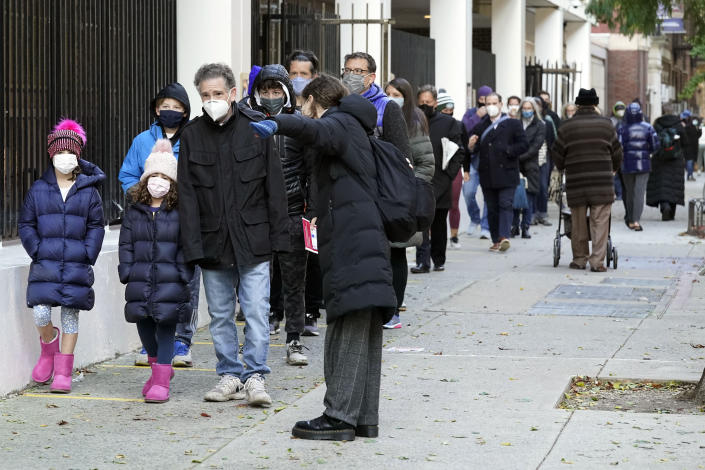 Voters line up outside Frank McCourt High School on Election Day, on New York's Upper West Side, Tuesday, Nov. 3, 2020. (AP Photo/Richard Drew)