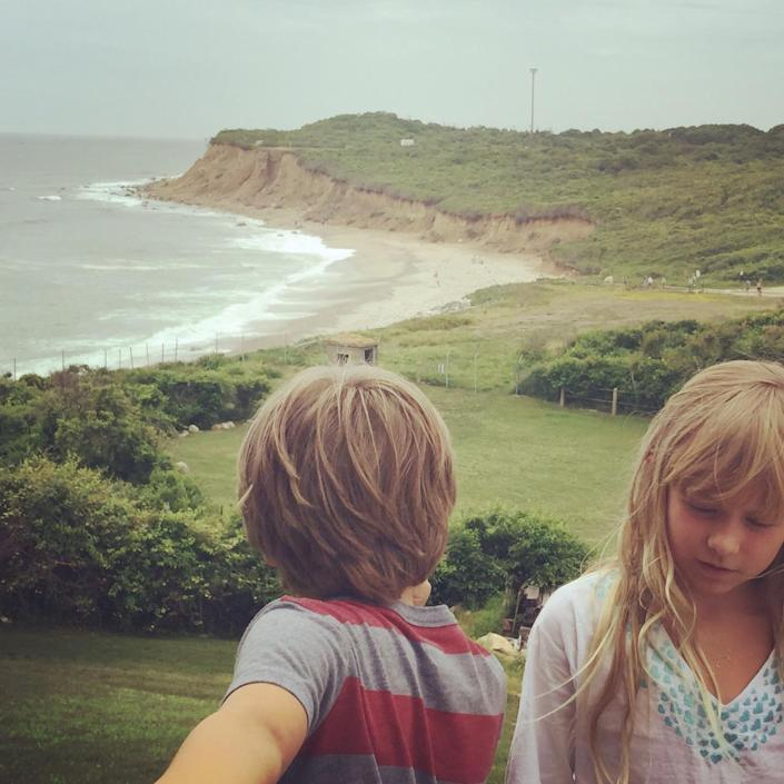 """<p>The 2-acre property includes a bluff that's 70 feet above Long Island's Fort Pond Bay. """"It's cool and craggy and it looks a little bit like the Costa Brava"""" in Spain, Laura says. Here are her two children, Anton and Isadora, enjoying the view.<br></p>"""