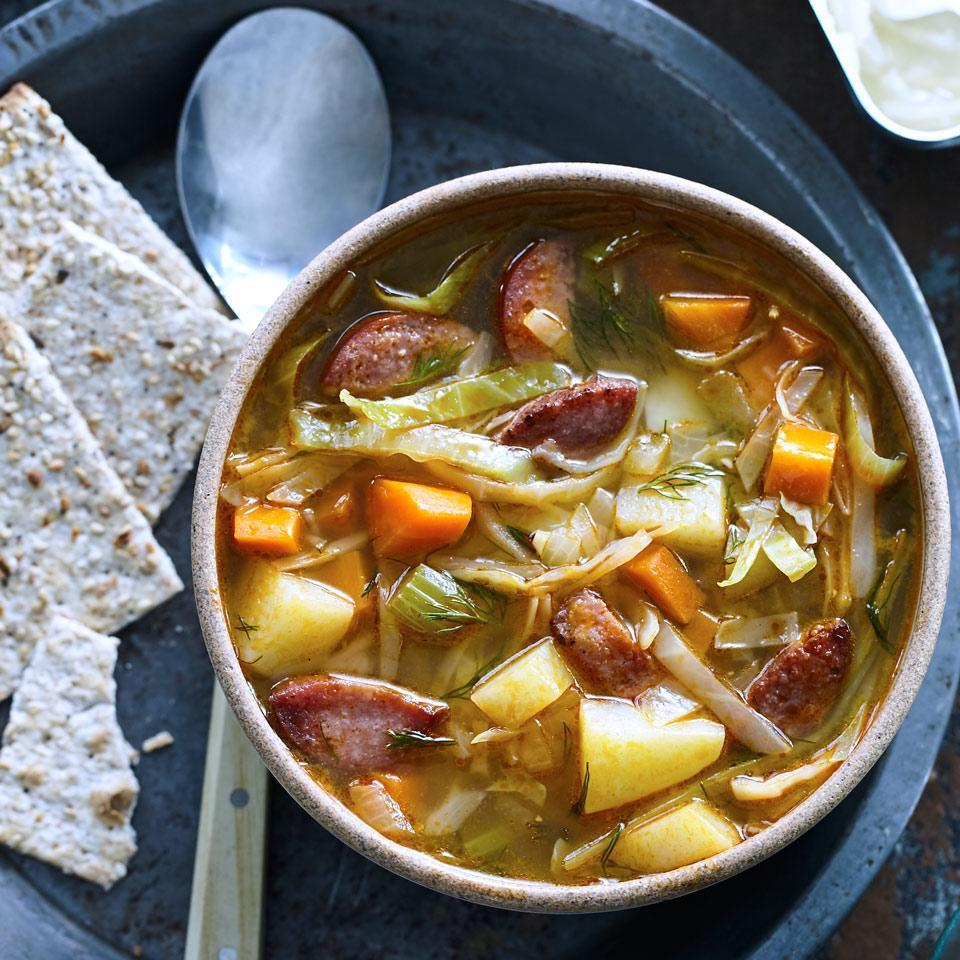 <p>This Eastern European soup (called kapusniak in Polish) is traditionally made with sauerkraut. To keep the sodium in check in this healthy recipe, we use fresh cabbage and save the sauerkraut for a deliciously salty-sour garnish.</p>