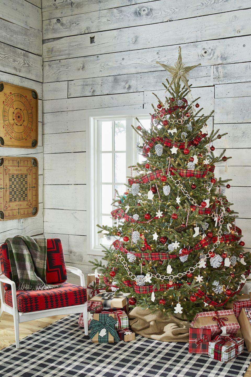 """<p>Red tartan plaid is always right for the holidays! Choose wire-edged ribbon that's at least two inches wide for a high-impact garland. </p><p><a class=""""link rapid-noclick-resp"""" href=""""https://www.amazon.com/Berwick-2-Inch-50-Yard-Clarkston-Ribbon/dp/B0091SC1AO/ref=sr_1_3?tag=syn-yahoo-20&ascsubtag=%5Bartid%7C10050.g.28703522%5Bsrc%7Cyahoo-us"""" rel=""""nofollow noopener"""" target=""""_blank"""" data-ylk=""""slk:SHOP PLAID RIBBON"""">SHOP PLAID RIBBON</a></p>"""