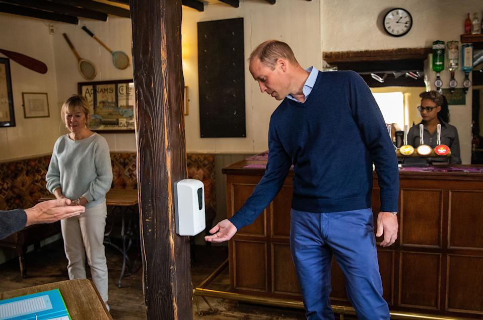 EMBARGOED TO 2230 BST FRIDAY JULY 3 The Duke of Cambridge uses hand sanitiser as he enters The Rose and Crown pub in Snettisham, Norfolk.