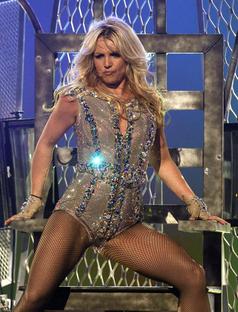 """FILE -  In this March 27, 2011, file photo singer Britney Spears performs on ABC's """"Good Morning America"""" show at the Bill Graham Civic Auditorium in San Francisco.  The singer who created a sensation when she hit the music world in pigtails and knee socks is turning 30 _ and Britney Spears says she's looking forward to it. Spears kicks off a string of European tour dates Thursday Sept. 22, 2011 in St. Petersburg, but is not scheduled to play on the birthday itself. She has spent the summer performing across North America to generally positive reviews. (AP Photo/Tony Avelar, file)"""