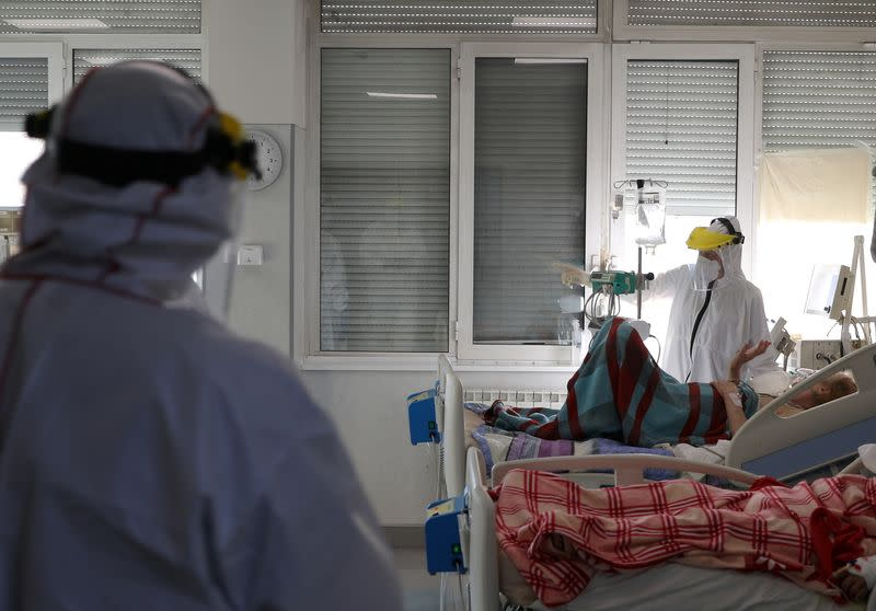 Medical workers treat a patient suffering from the coronavirus disease (COVID-19) at Saint Anna hospital in Sofia