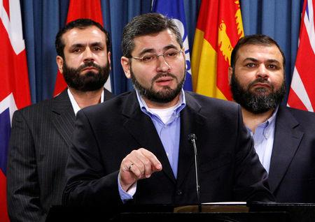 FILE PHOTO --  Abdullah Almalki, with Muayyed Nureddin and Ahmad El Maati, speaks during a news conference on Parliament Hill in Ottawa