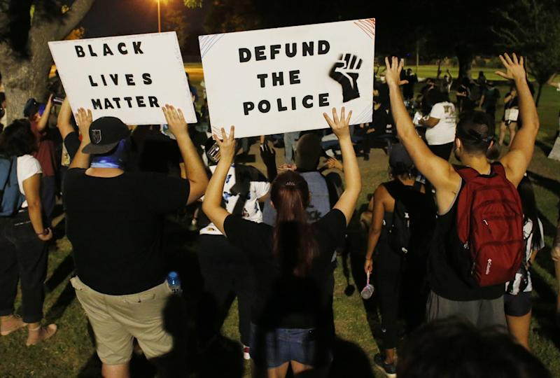 Protesters gather during a Defund the Police rally at Meyer Park in Tempe on June 25, 2020.