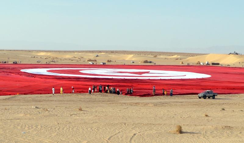 A giant Tunisian national flag unfurled at Ong Jmel in the southern desert