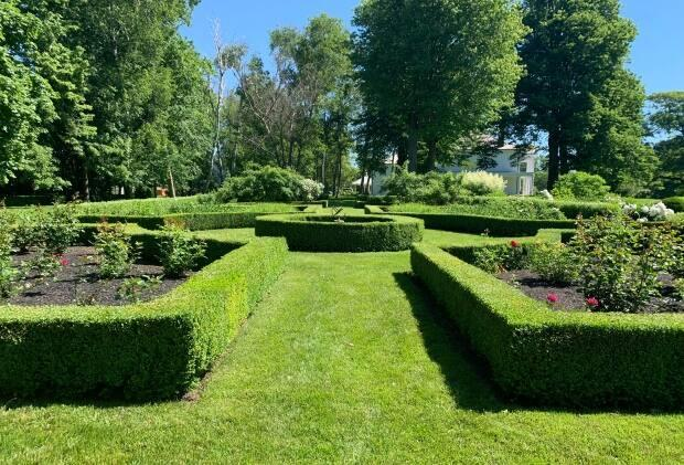 The formal Victorian-style gardens at Fanningbank, the estate of P.E.I.'s lieutenant-governor, are bordered in neatly groomed boxwood.  (Sara Fraser/CBC - image credit)