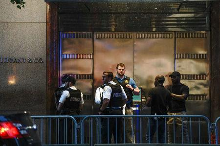 Police stand outside Trump Tower on 5th Avenue in New York City U.S