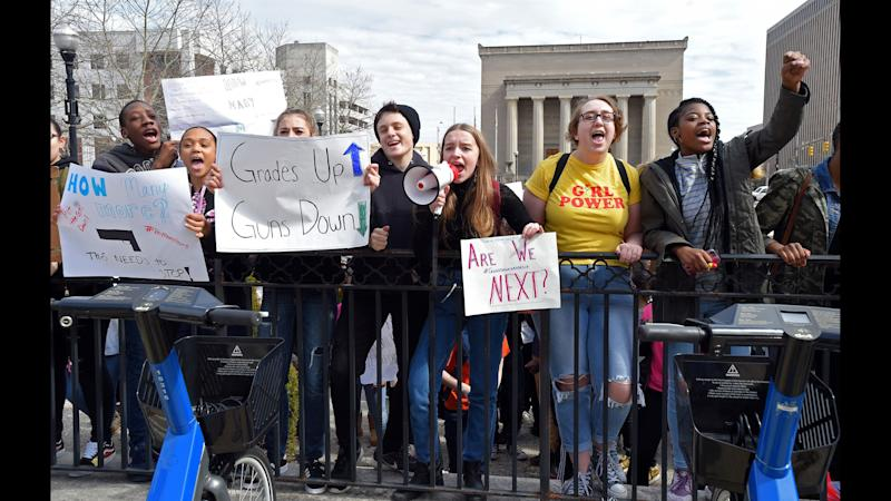 Baltimore students, seen outside of City Hall on Tuesday, participated in a walkout to protest gun violence in schools and the city.