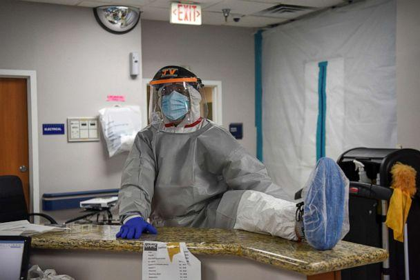 PHOTO: Dr. Joseph Varon, the chief medical officer at United Memorial Medical Center wears personal protective equipment as he stretches his legs before treating COVID-19 patients at UMMC in Houston, Texas, July 25, 2020. (Callaghan O'hare/Reuters)