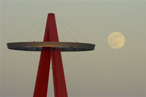 """The moon rises next the Los Angeles Angels' """"Big A"""" sign during their baseball game against the Pittsburgh Pirates, Saturday, June 22, 2013, in Anaheim, Calif. (AP Photo/Mark J. Terrill)"""