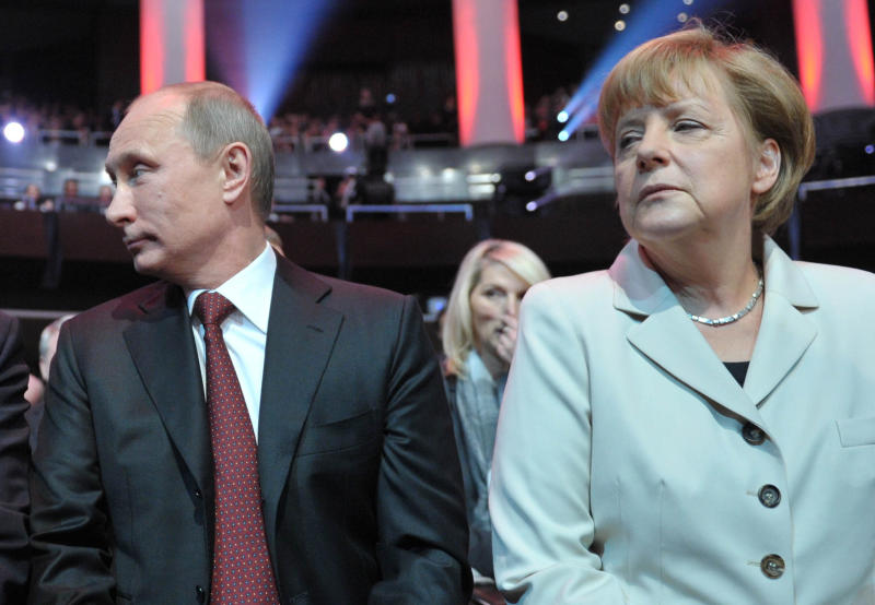 German Chancellor Angela Merkel, right, and Russian President Vladimir Putin, left, attend the opening of the Hannover Fair at the Congress Center in Hannover, Germany, Sunday April 7, 2013. (AP Photo/RIA Novosti, Alexei Druzhinin, Presidential Press Service)