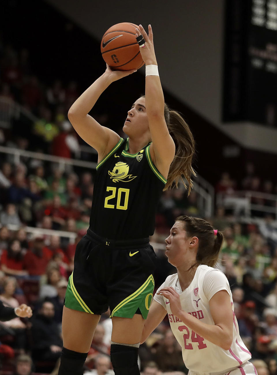 Oregon Ducks guard Sabrina Ionescu (20) shoots over Stanford's Lacie Hull, right, during the first half of an NCAA college basketball game Monday, Feb. 24, 2020, in Stanford, Calif. (AP Photo/Ben Margot)