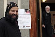 A Coptic and a catholic priest, right, walk outside the Augustinianum institute where an international congress on Coptic studies is held in Rome, Wednesday, Sept. 19, 2012. Scholars are questioning the authenticity and significance of a much-publicized discovery by a Harvard scholar who reported that a 4th Century fragment of papyrus has provided the first evidence that some early Christians believed Jesus was married. Karen King, a professor at Harvard Divinity School, announced the finding Tuesday at an international congress on Coptic studies in Rome. (AP Photo/Gregorio Borgia)