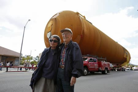 Frank Elston, 93 and Florence Elston, 91, pose for a photo as the space shuttle Endeavour's external fuel tank ET-94 makes its way to the California Science Center in Exposition Park in Los Angeles, California, U.S. May 21, 2016. REUTERS/Lucy Nicholson