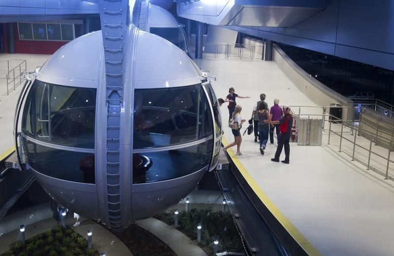 Passengers leave the cabin after riding the 550 foot-tall (167.6 m) High Roller observation wheel, the tallest in the world, in Las Vegas