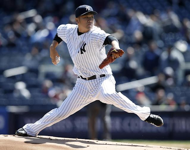 New York Yankees starting pitcher Masahiro Tanaka delivers in the first inning of the first game of an interleague baseball doubleheader against the Chicago Cubs at Yankee Stadium in New York, Wednesday, April 16, 2014. (AP Photo/Kathy Willens)