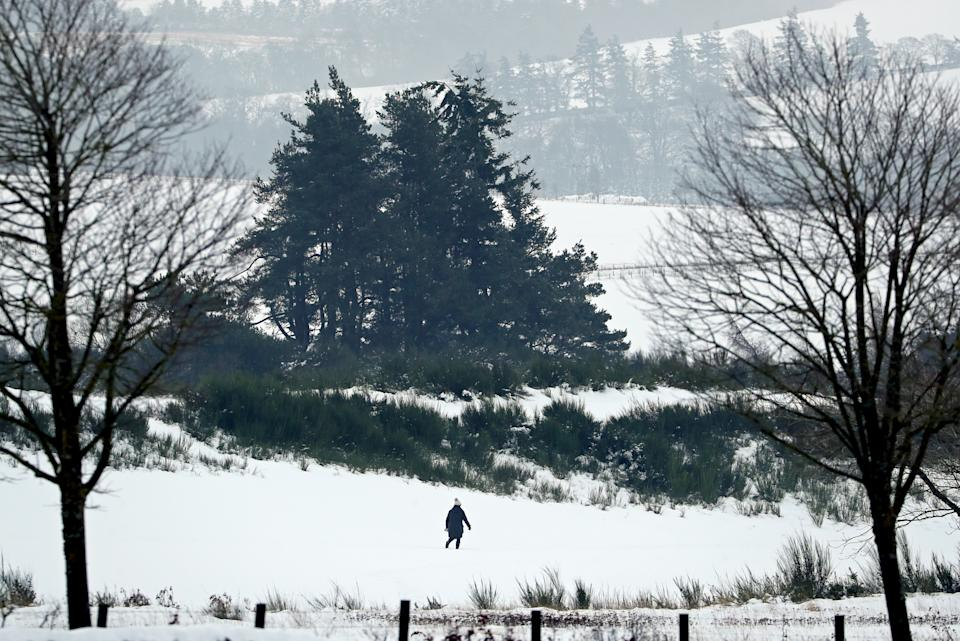 A person walks along the snow covered golf course at Gleneagles in Auchterarder, Perthshire. Heavy snow and freezing rain is set to batter the UK this week, with warnings issued over potential power cuts and travel delays. (Photo by Andrew Milligan/PA Images via Getty Images)
