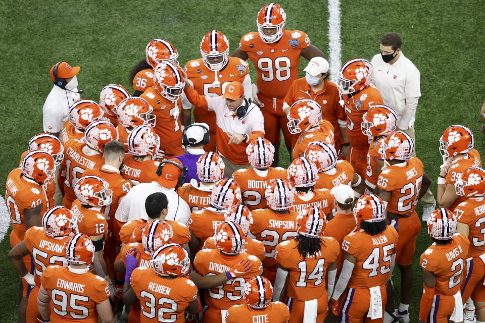 Clemson head coach Dabo Swinney talks with his team during the second half of the Sugar Bowl NCAA college football game against Ohio State Friday, Jan. 1, 2021, in New Orleans. (AP Photo/Butch Dill)
