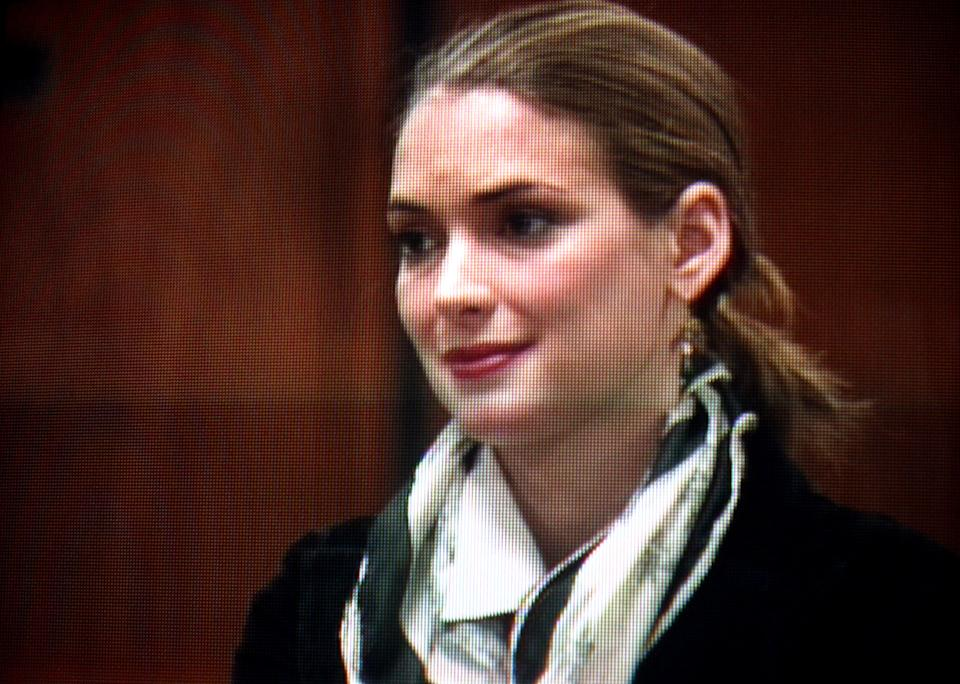 An image taken from a pool video shows actress Winona Ryder during a progress report hearing, Friday, June 18, 2004, in Beverly Hills, Calif. The judge in actress Winona Ryder's shoplifting case reduced her felony convictions to misdemeanors Friday and allowed her to finish probation unsupervised. After reviewing Ryder's probation report, Superior Court Judge Elden Fox warned the actress that if she breaks the law before the end of her probation in December 2005, she would be sent to jail. (AP Photo/Pool)