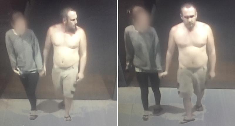 A man is seen shirtless walking into a supermarket.