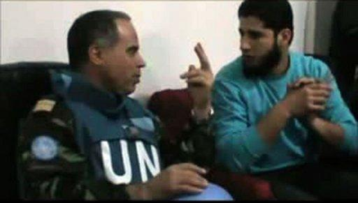 Moroccan UN observer, Colonel Ahmed Himmiche, speaking to Abdul Razzaq Tlas (R), leader of the Katibat al-Faruqin