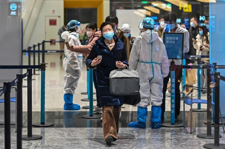 Passengers wear masks at the Tianhe International Airport in Wuhan