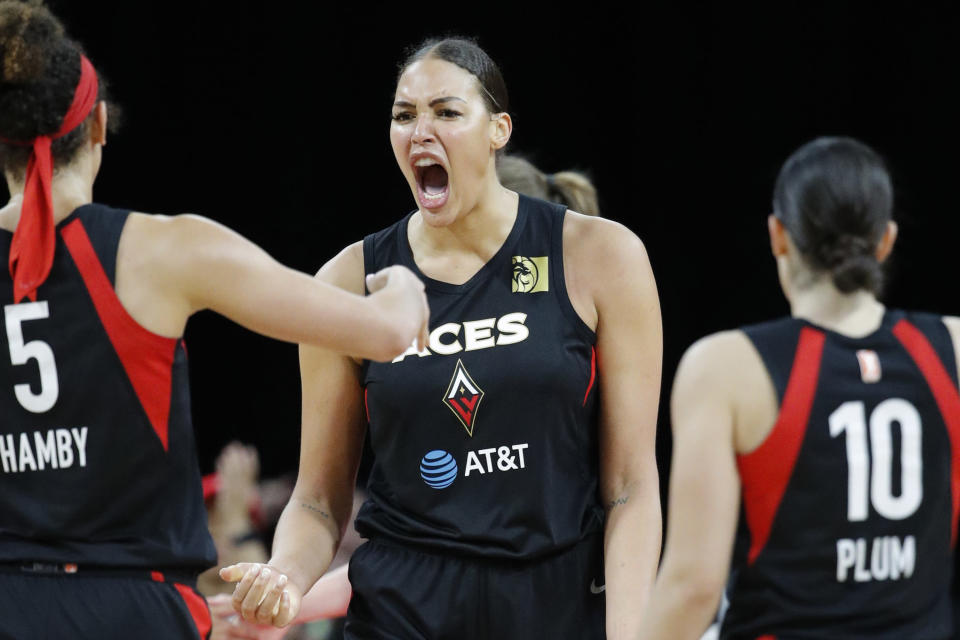 FILE - In this Sept. 24, 2019, file photo, Las Vegas Aces' Liz Cambage, center, celebrates after a play against the Washington Mystics during the second half of Game 4 of a WNBA playoff basketball series in Las Vegas. WNBA All-Star center Liz Cambage is set to return to the Australian women's basketball league after signing with the Southside Flyers. (AP Photo/John Locher, File)