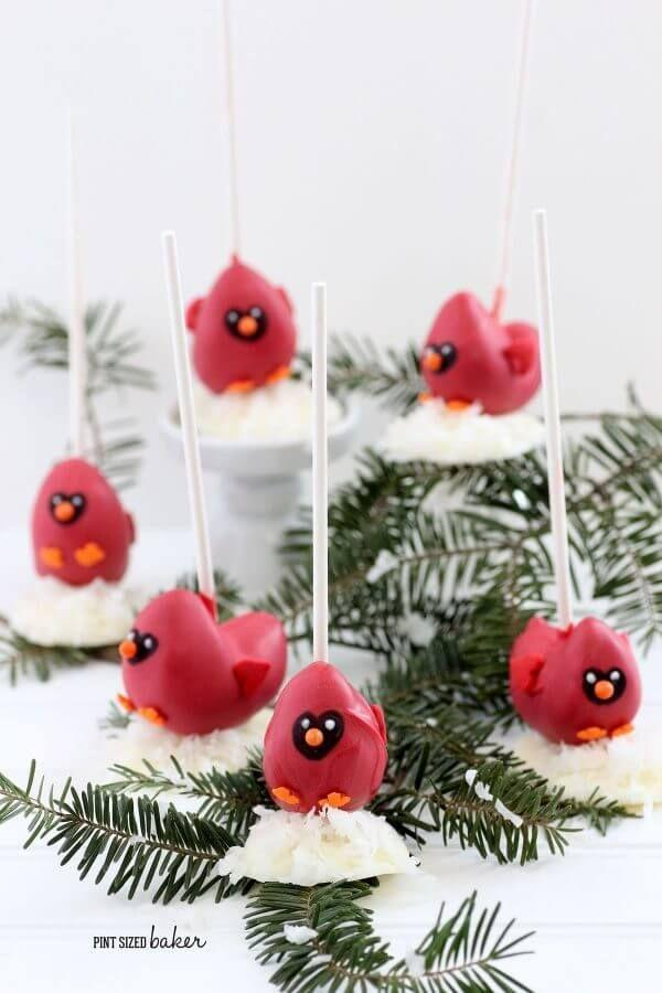 """<p>Perhaps a better cake pop idea for advanced bakers, these cardinal-themed desserts are an elegant Christmas finger food.</p><p><strong>Get the recipe at <a href=""""https://pintsizedbaker.com/cardinal-cake-pop-tutorial-and-bakerella-giveaway/"""" rel=""""nofollow noopener"""" target=""""_blank"""" data-ylk=""""slk:Pint Sized Baker"""" class=""""link rapid-noclick-resp"""">Pint Sized Baker</a>. </strong></p><p><strong><strong><a class=""""link rapid-noclick-resp"""" href=""""https://www.amazon.com/Lollipop-sticks-100-count-inch/dp/B000W5CGR8?tag=syn-yahoo-20&ascsubtag=%5Bartid%7C10050.g.22841709%5Bsrc%7Cyahoo-us"""" rel=""""nofollow noopener"""" target=""""_blank"""" data-ylk=""""slk:SHOP LOLLIPOP STICKS"""">SHOP LOLLIPOP STICKS</a></strong><br></strong></p>"""