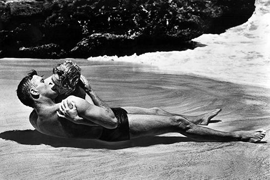 """<em><strong><h3>From Here To Eternity</h3></strong></em><h3> (1953)<br></h3>The scene with Deborah Kerr and Burt Lancaster kissing on the beach is iconic and unforgettable.<br><br><span class=""""copyright"""">Photo: Courtesy of Columbia Pictures.</span>"""