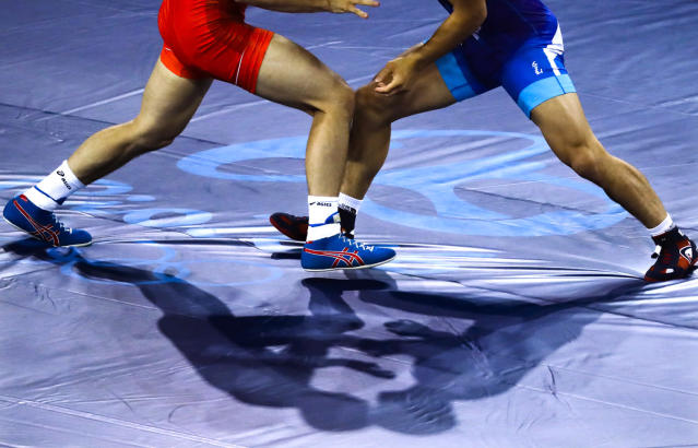 <p>China's Yang Bin, red, competes against Morocco 's Zied Ait Ouagram during the during the men's Greco-Roman competition at the 2016 Summer Olympics in Rio de Janeiro, Brazil, Sunday, Aug. 14, 2016. (AP Photo/Markus Schreiber) </p>