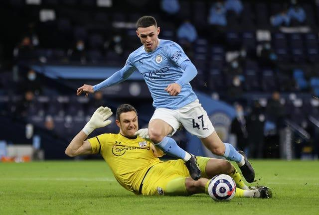 Phil Foden should have been awarded a penalty when he was caught by Southampton goalkeeper Alex McCarthy but stayed on his feet, referees' chief Mike Riley said