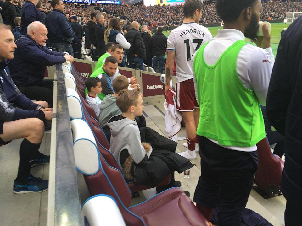 Burnley players gave up their seats on the bench to help young fans stay safe (Johnny Phillips/Twitter)