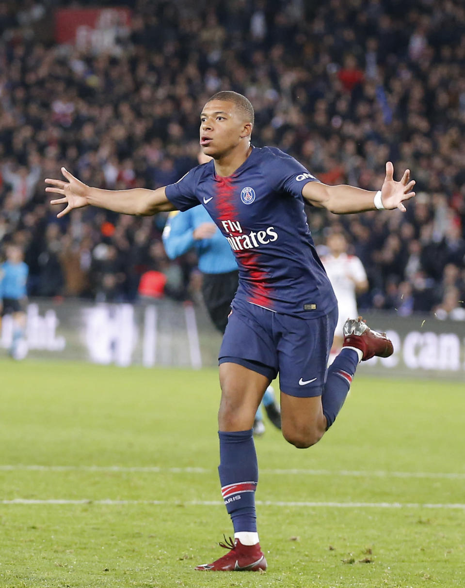PSG's Kylian Mbappe celebrates after scoring his side's fourth goal during the French League One soccer match between Paris-Saint-Germain and Lyon at the Parc des Princes stadium in Paris, France, Sunday, Oct. 7, 2018. (AP Photo/Michel Euler)