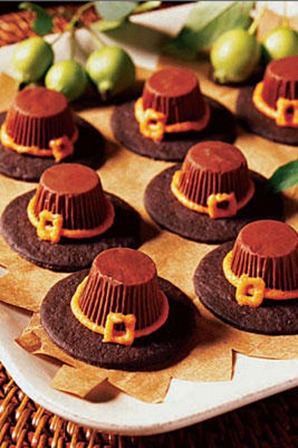 "<p>Peanut butter cups and chocolate wafer cookies are the secret to making these <a href=""https://www.womansday.com/food-recipes/food-drinks/g1966/thanksgiving-cupcakes/"" rel=""nofollow noopener"" target=""_blank"" data-ylk=""slk:adorable treats"" class=""link rapid-noclick-resp"">adorable treats</a>.</p><p><strong><em><a href=""https://www.womansday.com/food-recipes/food-drinks/recipes/a10213/pilgrim-hat-cookies-121639/"" rel=""nofollow noopener"" target=""_blank"" data-ylk=""slk:Get the Pilgrim Hat Cookies recipe."" class=""link rapid-noclick-resp"">Get the Pilgrim Hat Cookies recipe. </a></em></strong></p><p> _________________________________________________________<br><br><em>Want more recipes? </em><a href=""https://subscribe.hearstmags.com/subscribe/womansday/253396?source=wdy_edit_article"" rel=""nofollow noopener"" target=""_blank"" data-ylk=""slk:Subscribe to Woman's Day"" class=""link rapid-noclick-resp""><em>Subscribe to Woman's Day</em></a><em> today and get </em><strong><em>73% off your first 12 issues</em></strong><em>. And while you're at it, </em><a href=""https://link.womansday.com/join/3o9/wdy-newsletter"" rel=""nofollow noopener"" target=""_blank"" data-ylk=""slk:sign up for our FREE newsletter"" class=""link rapid-noclick-resp""><em>sign up for our FREE newsletter</em></a><em> for even more of the Woman's Day content you want.</em><br><br><br></p>"