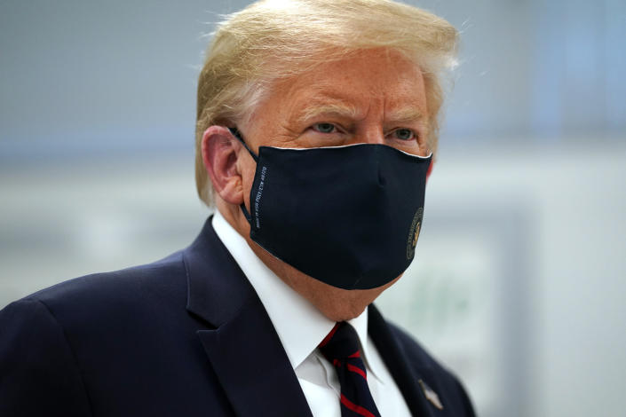 President Donald Trump wears a face mask as he participates in a tour of Bioprocess Innovation Center at Fujifilm Diosynth Biotechnologies, Monday, July 27, 2020, in Morrisville, N.C. (AP Photo/Evan Vucci)