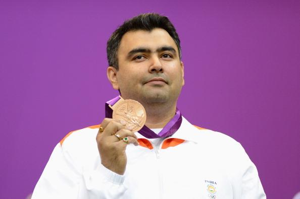 LONDON, ENGLAND - JULY 30: Bronze medallist Gagan Narang of India poses with the bronze medal won in the Men's 10m Air Rifle Shooting final final on Day 3 of the London 2012 Olympic Games at The Royal Artillery Barracks on July 30, 2012 in London, England.  (Photo by Lars Baron/Getty Images)