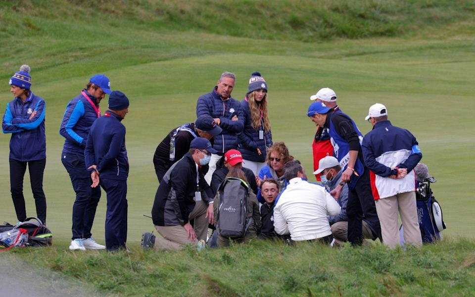 Tom Felton collapses on the 18th hole - REUTERS