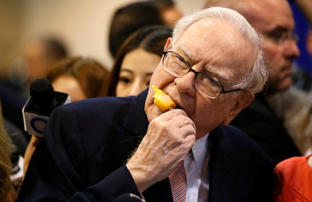 Berkshire Hathaway chairman and CEO Warren Buffett enjoys an ice cream treat from Dairy Queen before the Berkshire Hathaway annual meeting in Omaha, Nebraska, U.S. May 6, 2017. REUTERS/Rick Wilking TPX IMAGES OF THE DAY
