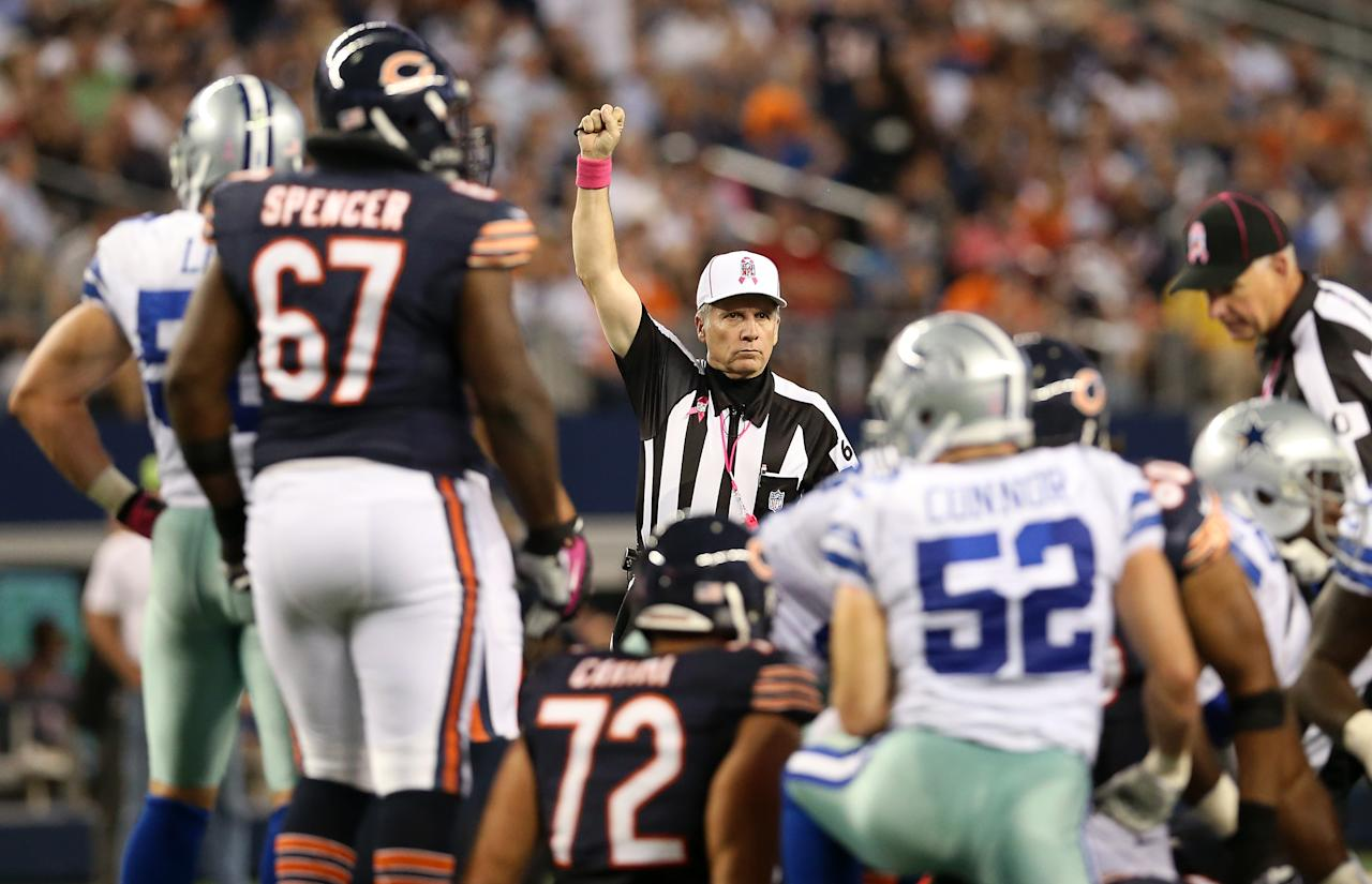 ARLINGTON, TX - OCTOBER 01:  Referee Walt Anderson #66 makes a call as the Chicago Bears play against the Dallas Cowboys at Cowboys Stadium on October 1, 2012 in Arlington, Texas.  (Photo by Ronald Martinez/Getty Images)