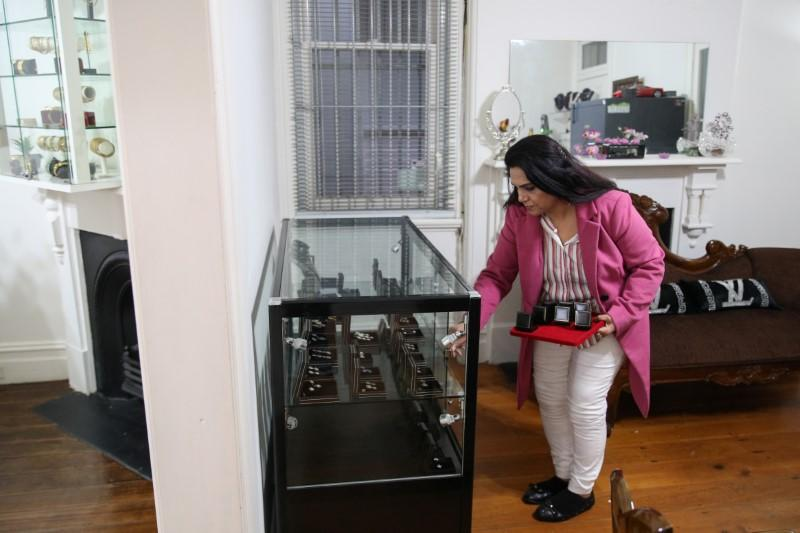 A jewellery designer attends to her shop amidst the easing of the coronavirus disease (COVID-19) restrictions, in Sydney