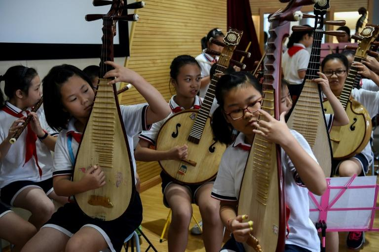 Students play Chinese musical instruments during a music session at their school in Shanghai, a city which has received huge attention in the West after the city's pupils aced worldwide standardised tests in recent years