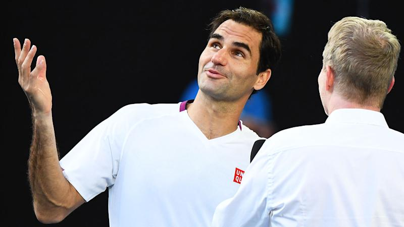 Pictured here, Roger Federer talks to Jim Courier about his epic quarter-final victory.