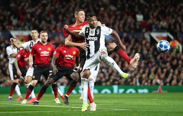 Manchester United's Nemanja Matic (left) and Juventus' Alex Sandro get in a tangle