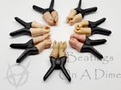 """So, they're nipple clamps…in the shape of baby doll hands. The description reads: """"It's really tight and painful, but the visual is so much worse for most,"""" and reviewers agree (in the best way possible). If you prefer to use nipple clamps for pleasure and want to add some creepiness to the mix, these come highly recommended by Etsy buyers. Each nipple clamp is sold individually. $8, Etsy. <a href=""""https://www.etsy.com/listing/772606966/doll-hand-nipple-clamps-unique-sadistic"""" rel=""""nofollow noopener"""" target=""""_blank"""" data-ylk=""""slk:Get it now!"""" class=""""link rapid-noclick-resp"""">Get it now!</a>"""