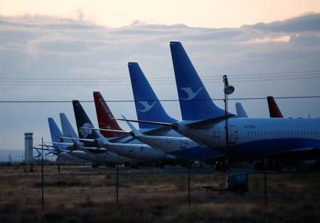 FILE PHOTO - The tails of Boeing 737 MAX aircraft are seen parked at Boeing facilities at the Grant County International Airport in Moses Lake