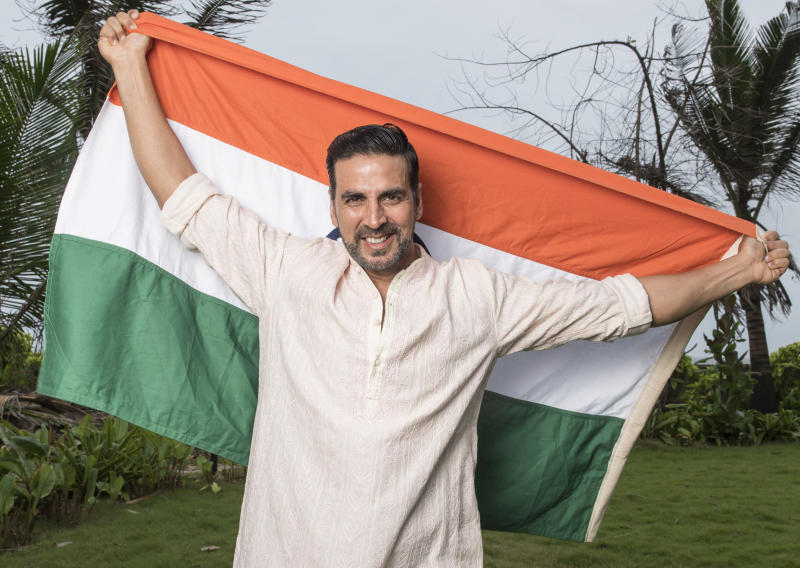 MUMBAI, INDIA - AUGUST 10: Bollywood actor Akshay Kumar poses with Indian flag for Independence Day shoot, on August 10, 2016 in Mumbai, India. (Photo by Aalok Soni/ Hindustan Times via Getty Images)