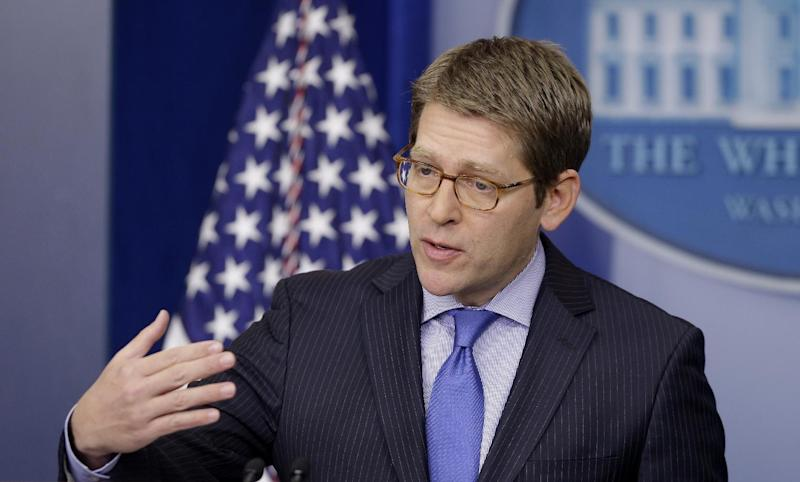 White House press secretary Jay Carney gestures as he briefs reporters at the White House in Washington, Tuesday, Feb. 19, 2013. (AP Photo/Charles Dharapak)