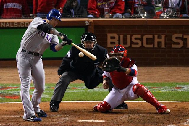ST LOUIS, MO - OCTOBER 20: Josh Hamilton #32 of the Texas Rangers hits an RBI sacrifice fly ball to tie the game in the ninth inning during Game Two of the MLB World Series against the St. Louis Cardinals at Busch Stadium on October 20, 2011 in St Louis, Missouri. (Photo by Dilip Vishwanat/Getty Images)